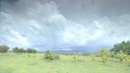 Ciemne chmury nad terenem zielonym