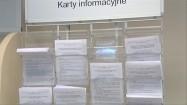 Karty informacyjne na stojaku