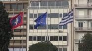 Flagi Aten, Grecji i Unii Europejskiej powiewające na wietrze