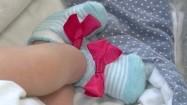 Kardiotokograf na brzuchu matki w ciąży