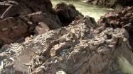 Suszenie ryb na skałach nad Mekongiem